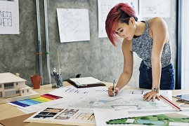 architect woman working on project plans